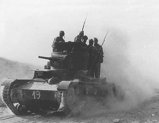 Republican International Brigadiers at the Battle of Belchite ride on a T-26 tank