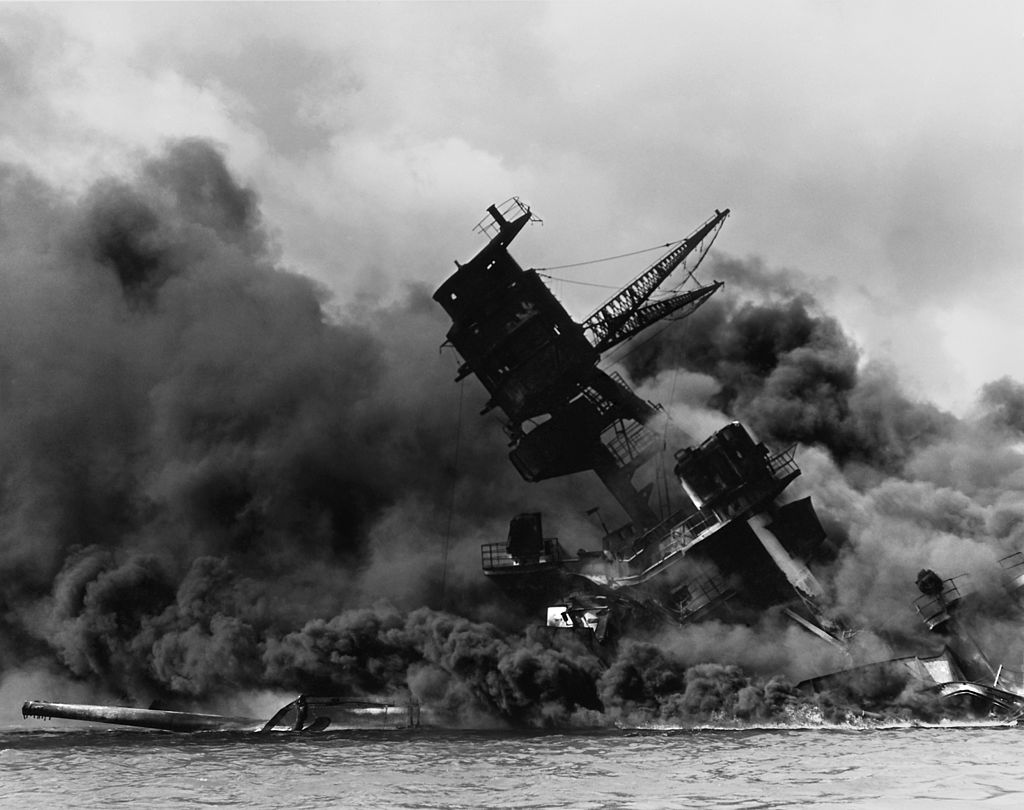 The USS Arizona (BB-39) burning after the Japanese attack on Pearl Harbor, 7 December 1941. By Photographer: Unknown Retouched by: Mmxx [Public domain or Public domain], via Wikimedia Commons. NAID: 195617.