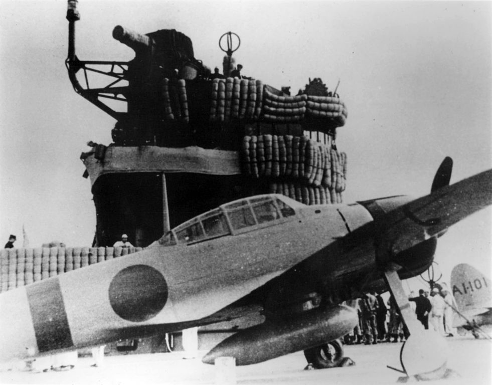 "An Imperial Japanese Navy Mitsubishi A6M2 ""Zero"" fighter on the aircraft carrier Akagi during the Pearl Harbor attack mission. By IJN [Public domain or Public domain], via Wikimedia Commons. AWM: P03172.003."