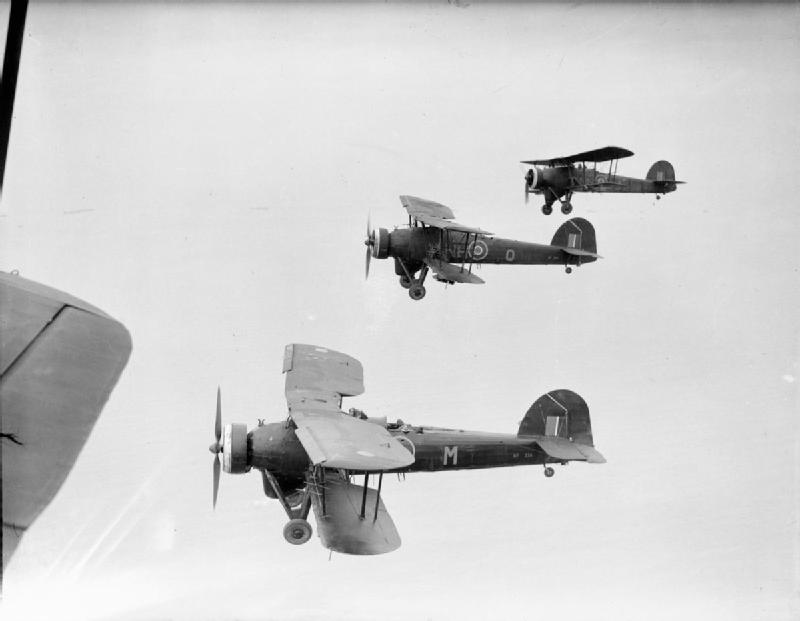Three Fairey Swordfish Mark IIIs (NF374 'NH-M', NF343 'NH-Q' and 'NH-L') of No. 119 Squadron RAF, based at B58/Knokke le Zoute, Belgium, flying in loose starboard echelon formation over the North Sea. Three Fairey Swordfish Mark IIIs (NF374 'NH-M', NF343 'NH-Q' and 'NH-L') of No. 119 Squadron RAF, based at B58/Knokke le Zoute, Belgium, flying in loose starboard echelon formation over the North Sea. By Daventry B J (Flt Lt), Royal Air Force official photographer [Public domain], via Wikimedia Commons. IWM: CL2290.
