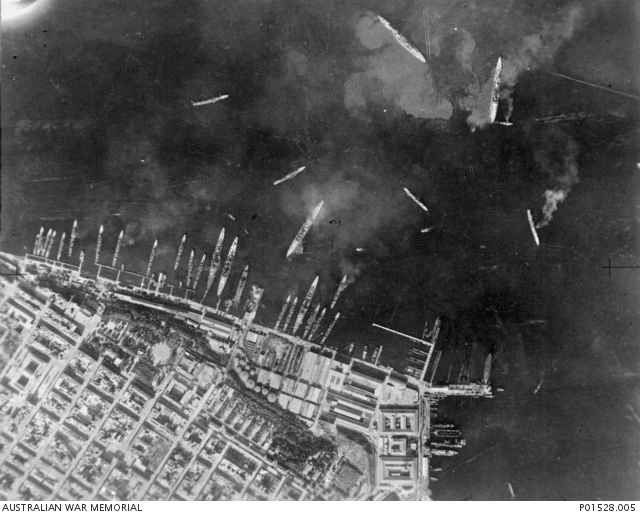 TARANTO, ITALY. 1940-11. AERIAL VIEW SHOWING AFTERMATH OF ACTION AGAINST THE ITALIAN FLEET IN TARANTO HARBOUR. NOTE THE TWO DAMAGED CRUISERS IN THE INNER HARBOUR.By C. Oliver [Public domain], via Wikimedia Commons. AWM: P01528.005.