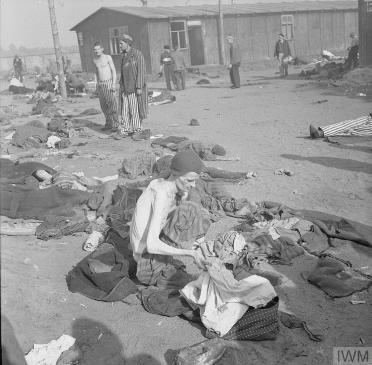 A camp inmate, reduced by starvation to a living skeleton, delouses his clothes, 17-18 April 1945. © IWM (BU 3766)