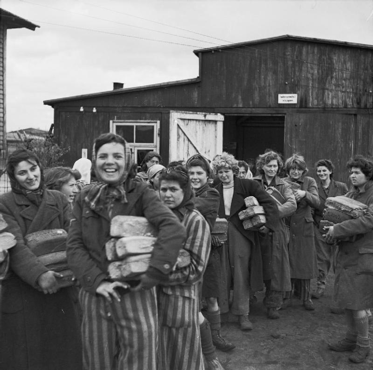 The Liberation of Bergen-belsen Concentration Camp, April 1945.Cheerful women inmates collect their bread ration from one of the five camp cookhouses. © IWM (BU 4274)